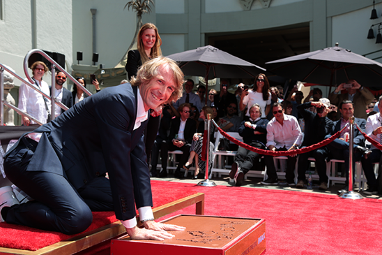 Transformers News: Images of Micheal Bay Being Honored with Hand and Footprint Ceremony by TCL Chinese Theatre IMAX