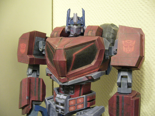 Transformers News: Detailed And Articulated WFC Optimus Papercraft Figure