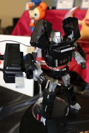Transformers News: New pictures of Megadrive Megatron and Playstation Optimus Prime