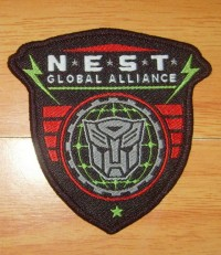 N.E.S.T. Global Alliance Iron On Clothing Patch