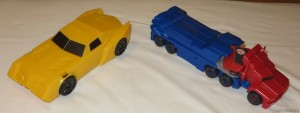 Transformers News: In hand Images of Robots in Disguise Titan Changers Optimus and Bumblebee and S