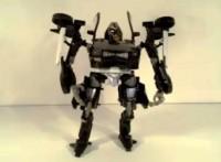 Video Review of Transformers DOTM Deluxe Class Mech Tech Barricade