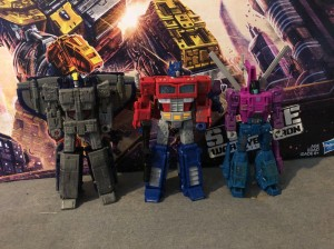 Size Comparisons of Siege Astrotrain with Siege Optimus Prime and Spinister