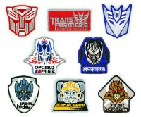 Transformers News: New Images ROTF Badges, Coins, Keychains and more
