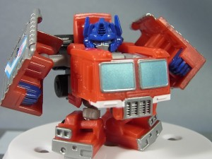 Transformers News: TakaraTomy Q Transformers: QT-19 Optimus Prime and QT-20 Megatron In Hand