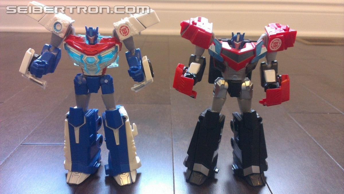 Transformers News: In Hand Pictures of TRU Exclusive White Redeco of Transformers RID Power Surge Optimus Prime Warrior