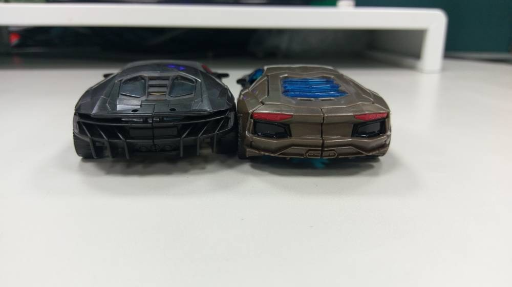 Transformers News: In Hand Images of Last Knight Deluxe Hot Rod with Comparisons to AOE Lockdown