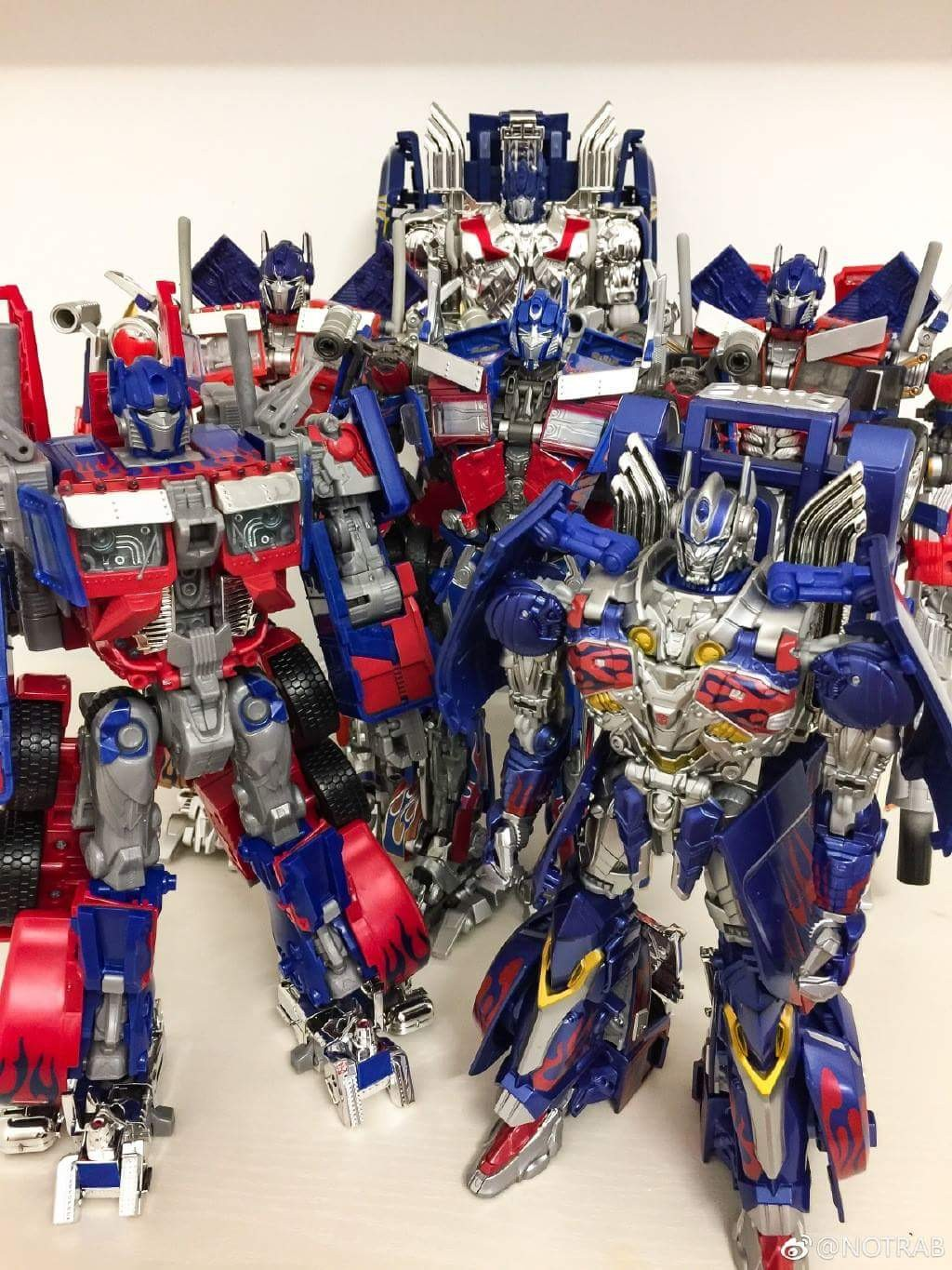 Transformers News: Comparison Shots for Transformers '07 Leader Optimus Prime Re-release, with MPM-4, The Last Knight