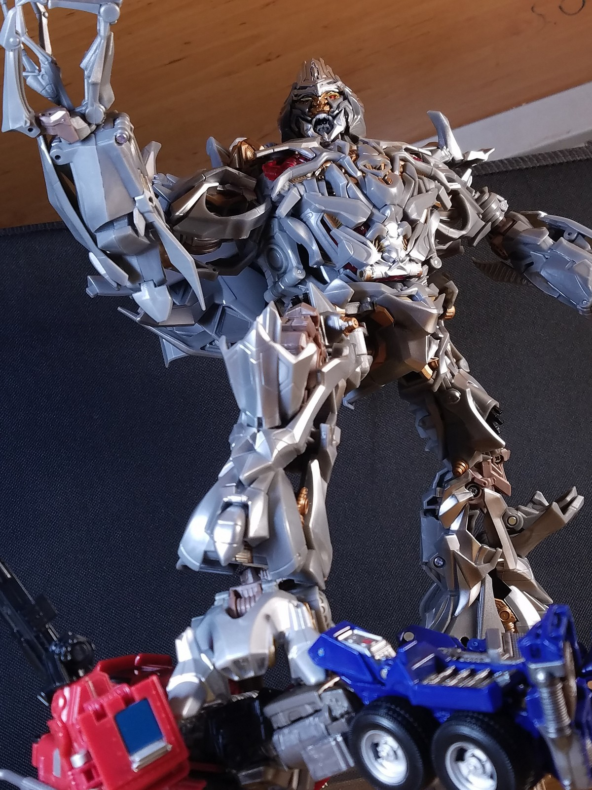 Transformers News: More In Hand Images of Movie Masterpiece Megatron MPM-08